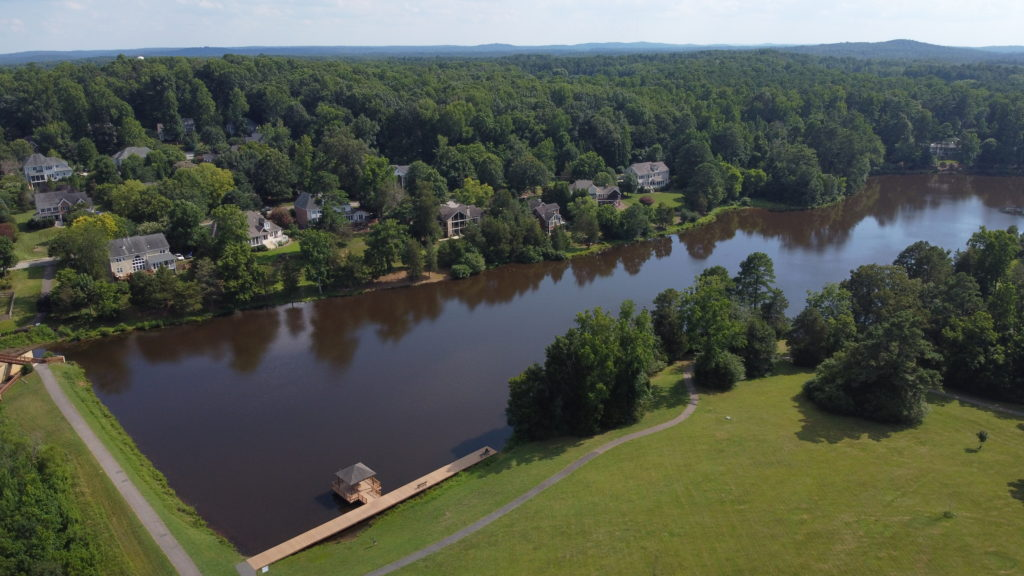 Aerial view of Lake Hogan, open green space and walking paths in Lake Hogan Farms in the town of Carrboro, North Carolina.